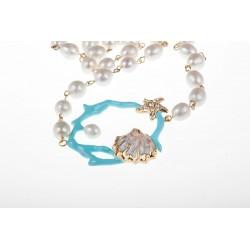 Collana di corallo turchese e un filo di perle bianche medie